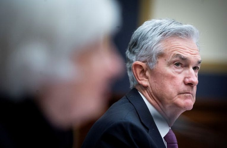 Fed lays out plan to reduce bond purchases, flags inflation worries